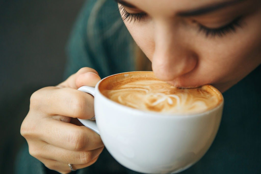 Close up girl is drinking coffee.